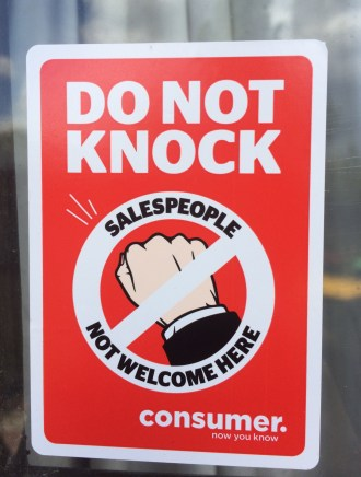 consumer nz's do not knock sticker attached to a window