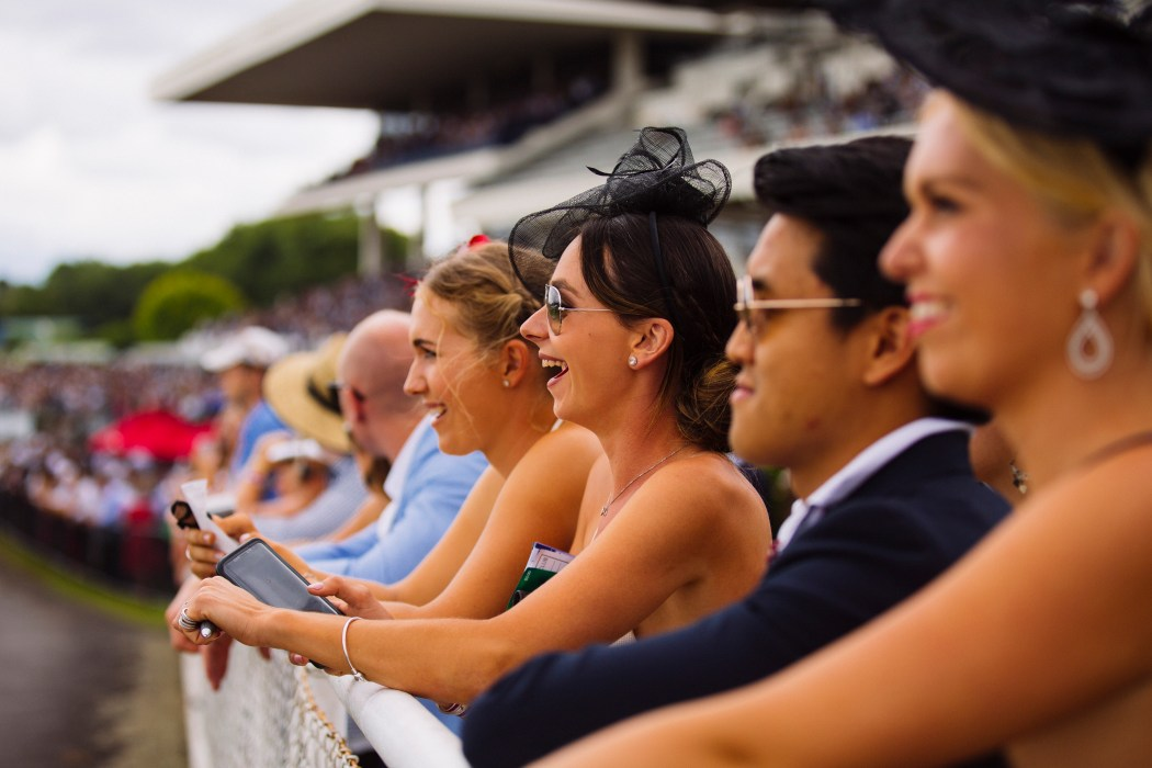 attendees at the Ellerslie racecourse watch horses run themselves to death