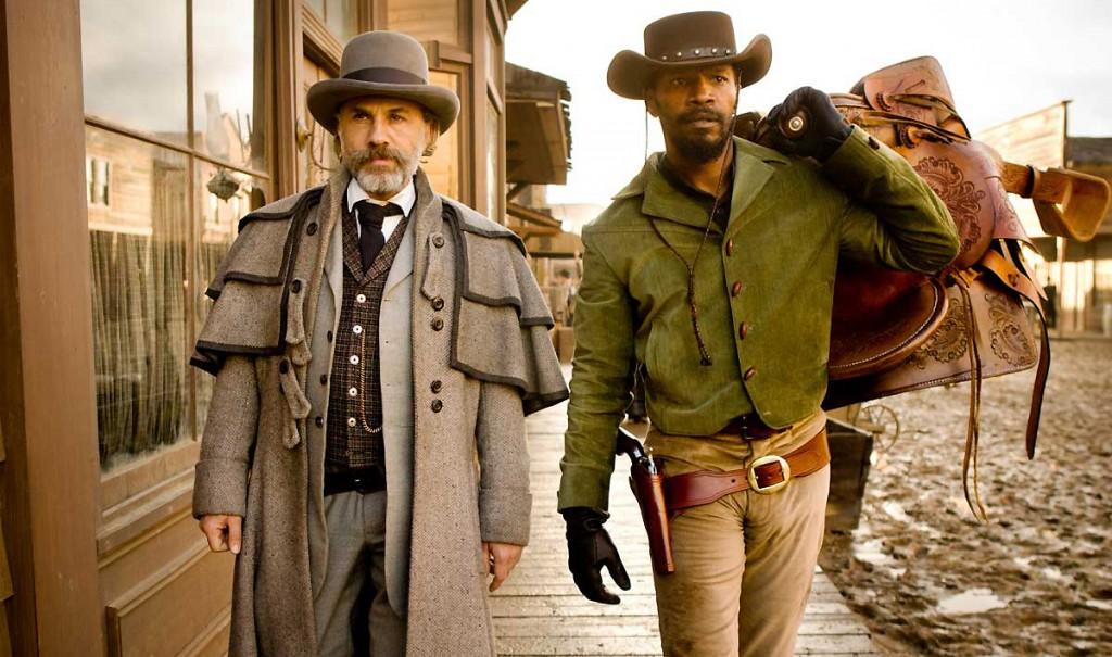 django unchained still - christoph waltz and jamie foxx walking down a wild west street