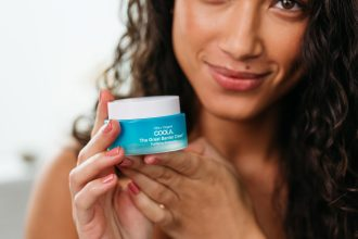 Girl holding COOLA product