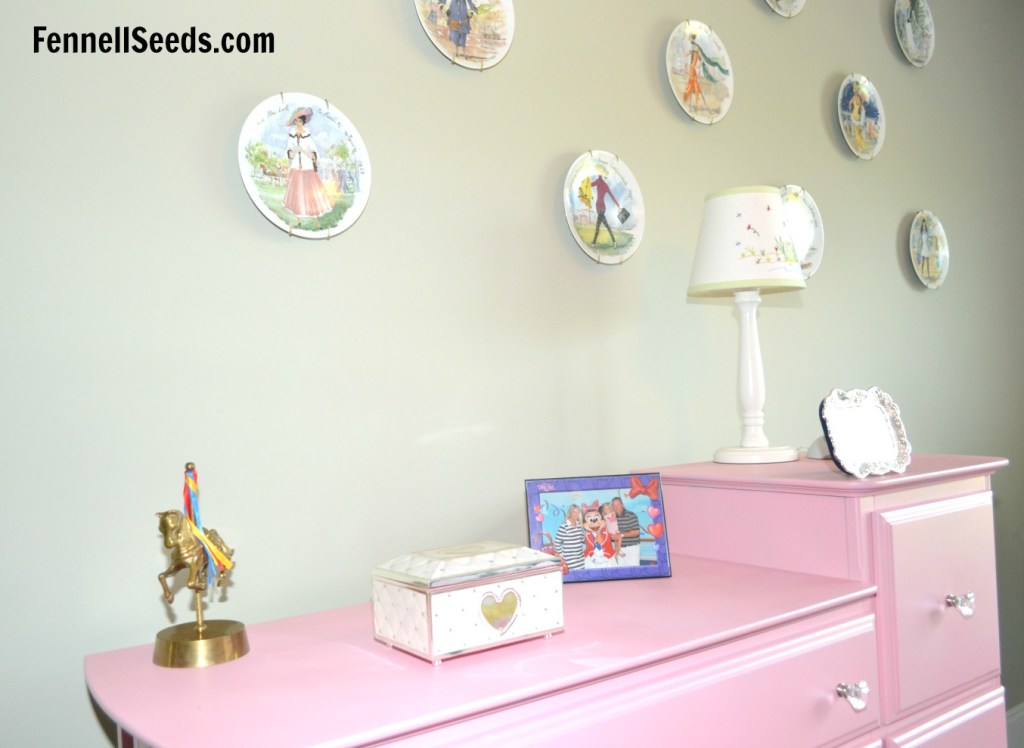 This dresser is spray painted pink. It was a diaper changing table and it was dressed up with spray paint and new knobs.