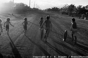 Children play with old tyres