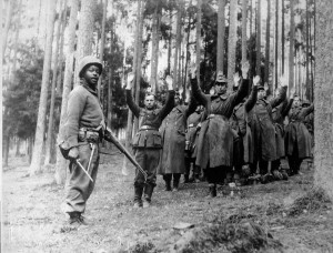 12th AD soldier with German prisoners of war, April 1945.