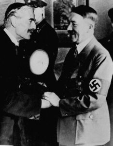 British Prime Minister Neville Chamberlain (left) and German Fuehrer Adolf Hitler shake hands at the 1938 Munich Conference in which Chamberlain agreed to allow Nazi Germany to annex the Sudetenland. September 1938 Munich, Germany