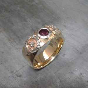 custom wedding band with ruby center gem and custom engraving