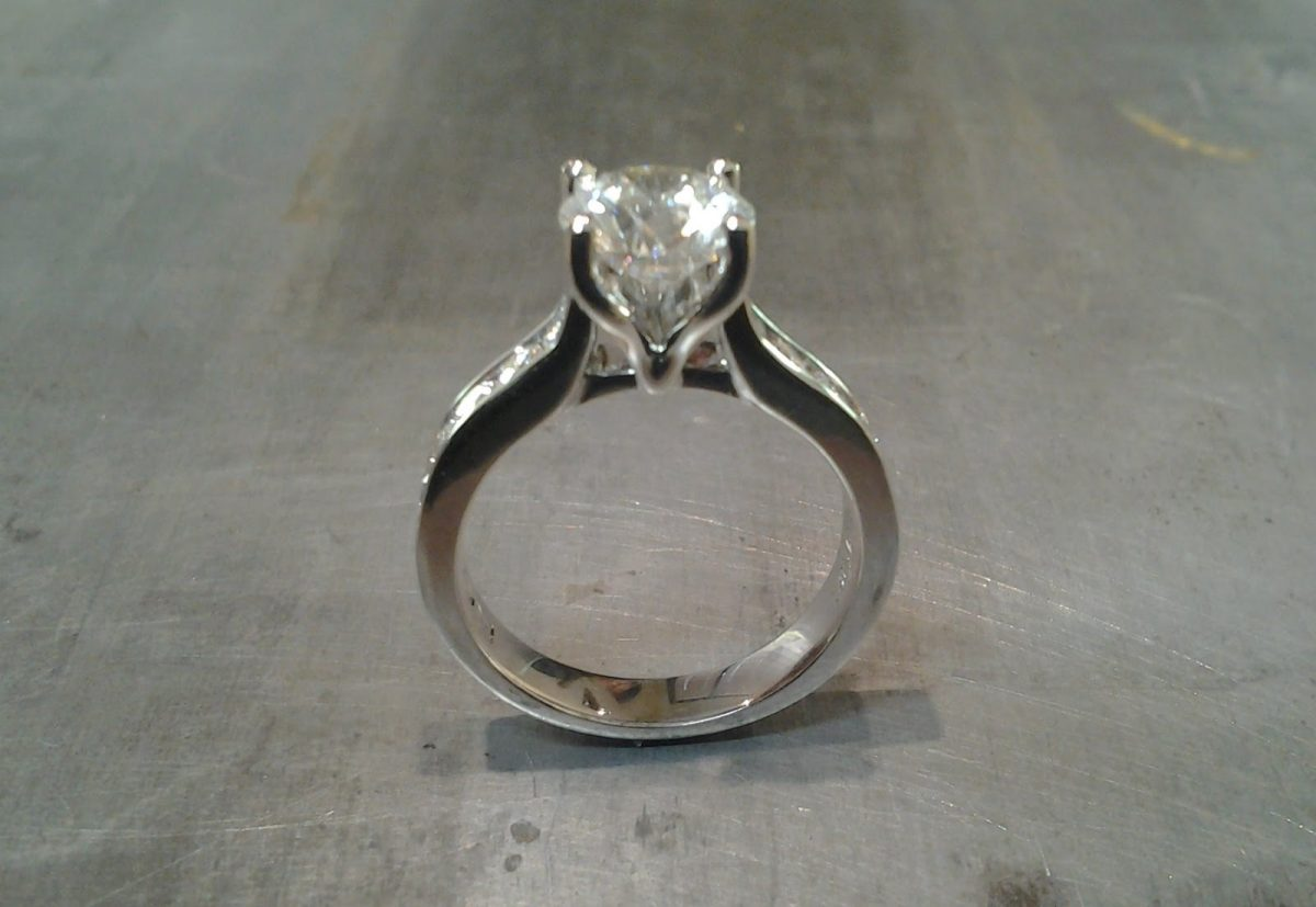 14k white gold engagement ring with princess cut diamond in cathedral setting