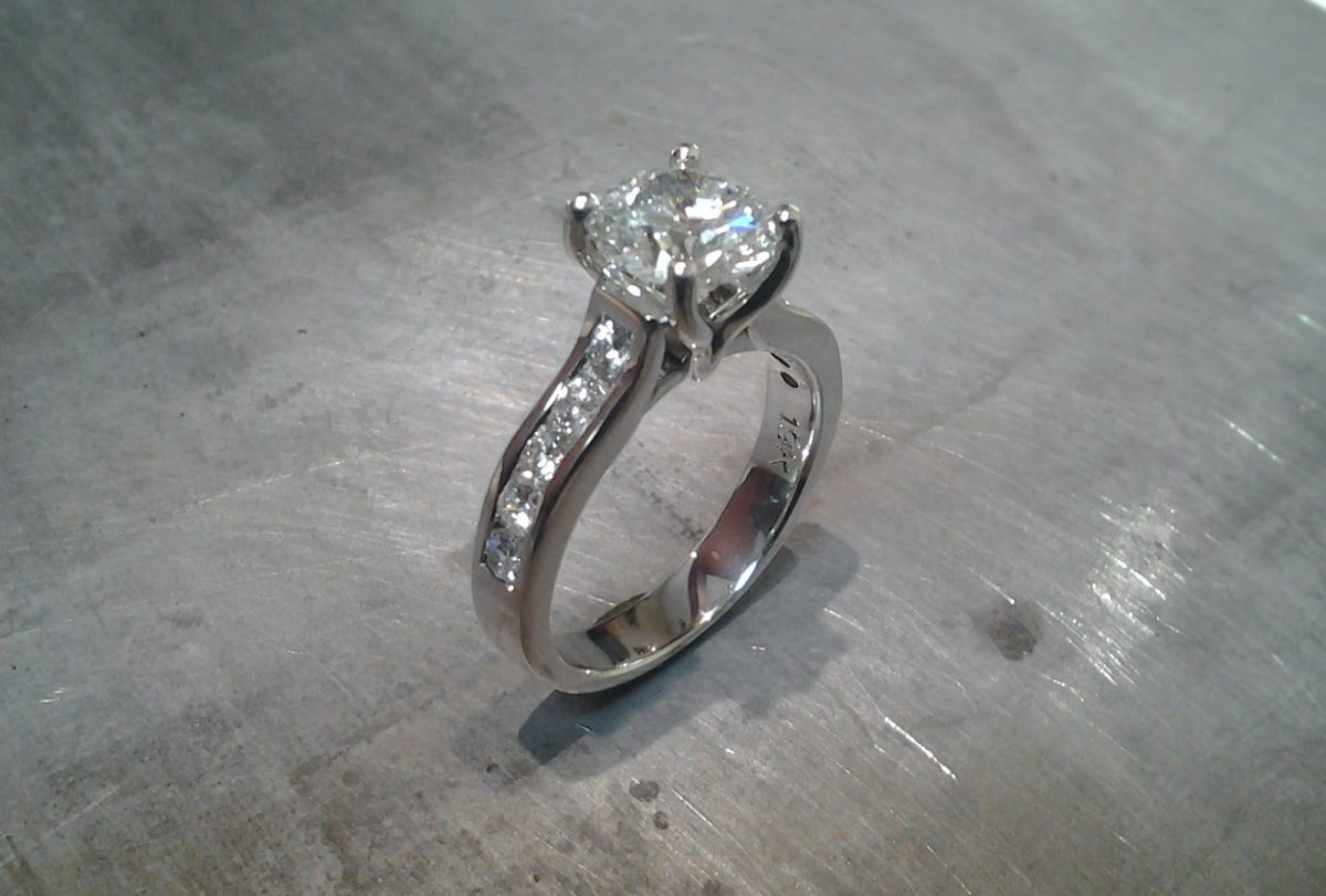 14k white gold engagement ring with princess cut diamond in cathedral setting and diamonds in band