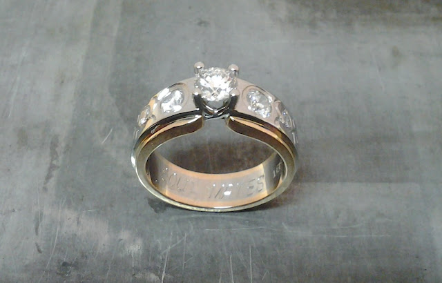 rose and white gold engagement ring with custom engraving and flush set diamond band top view