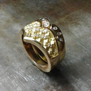 custom wedding ring with woven engraving and diamond cluster side view