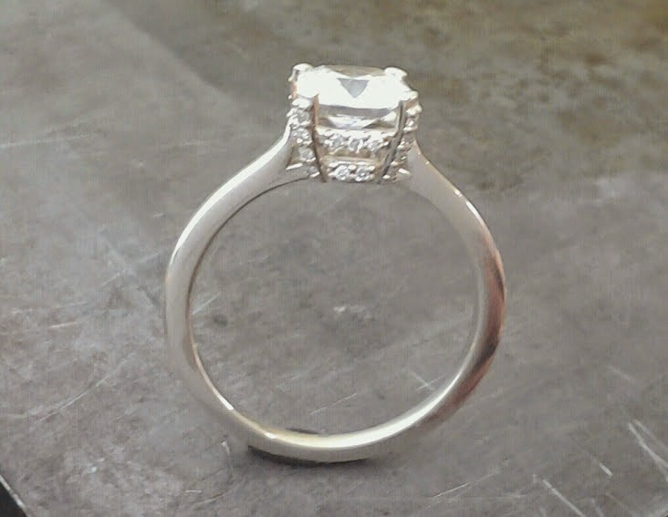 14k white gold slim band engagement ring with large princess cut diamond in a custom engraved channel setting 2