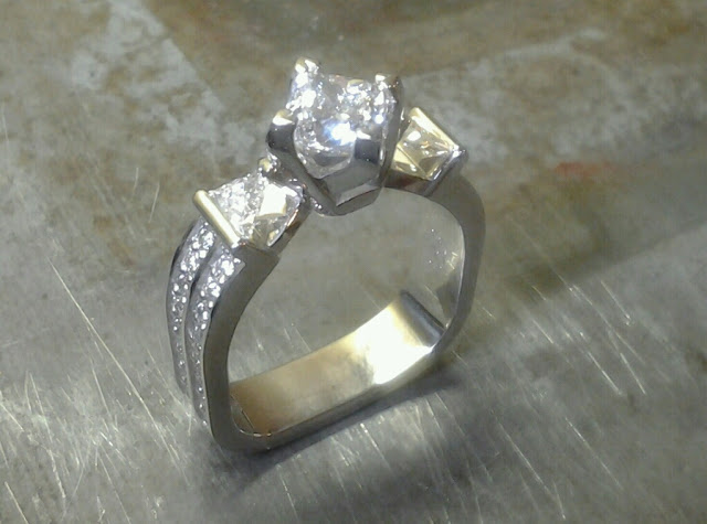 square shaped ring with triple set diamonds top view