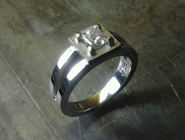 halo with no diamonds engagement ring