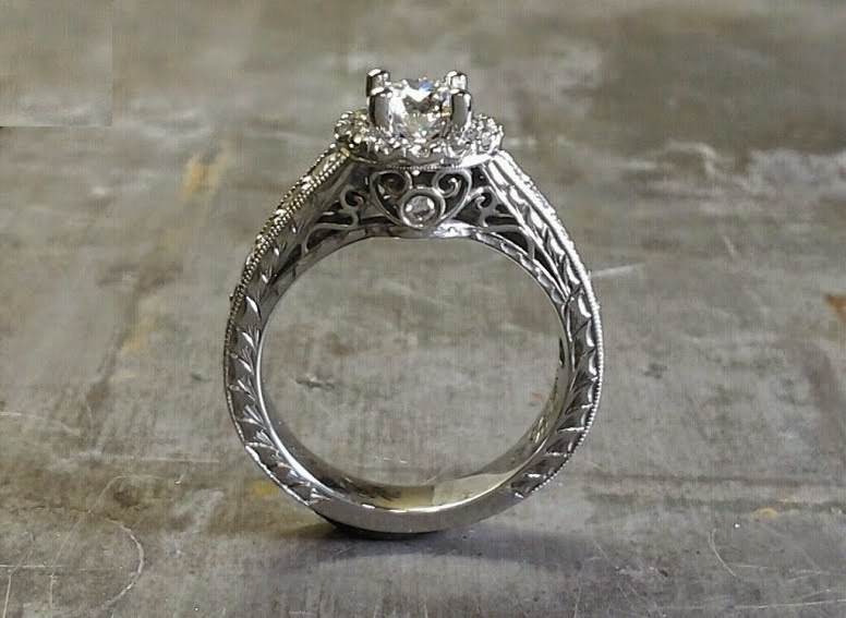 intriciate engagement ring band engraved with filigree and a princess cut diamond in a halo setting