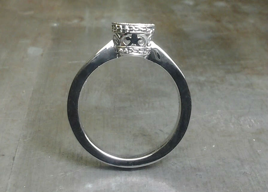 simple band with intricate round diamond setting