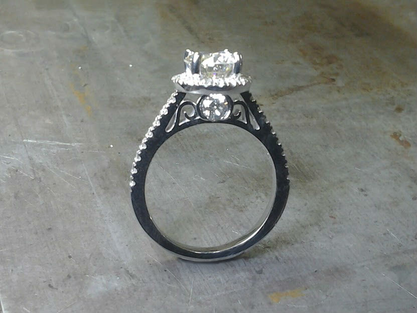 delicate white gold engagement ring with custom engraved band and large round center diamond side view