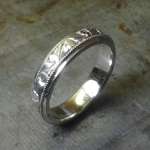 intricate custom engraved wedding band in white gold