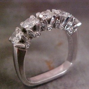 custom wedding ring with multiple diamond cluster