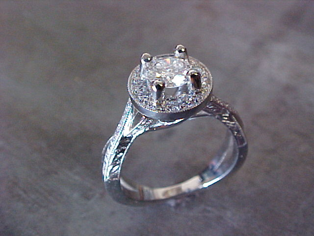 delicate engagement ring with custom designed band and round center diamond in halo setting