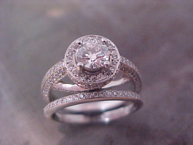 split diamond band engagement ring with round center diamond designed by sean ferguson