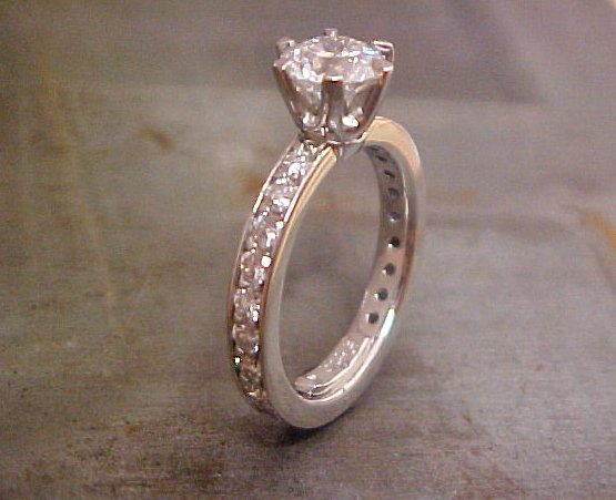white gold engagement ring with princess cut diamond in deep cathedral setting