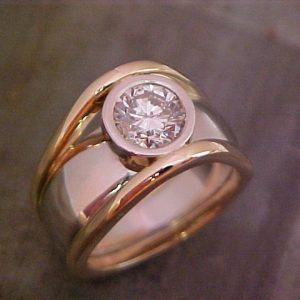 custom gold ring with round diamond in bezel setting