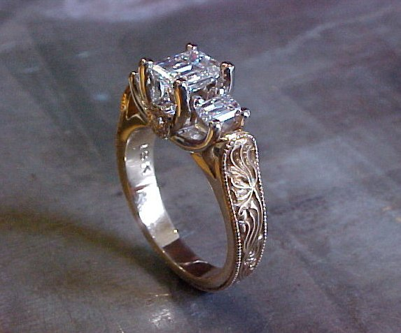 intricate art deco engagement ring with princess cut diamonds