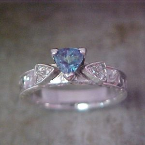 dainty white gold ring with custom engraving and light blue stone