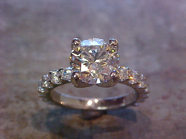 custom engagement ring with diamond band and large round diamond