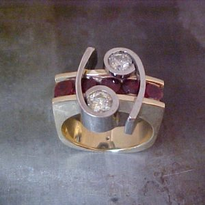 gold apostrophe ring with diamonds and rubies