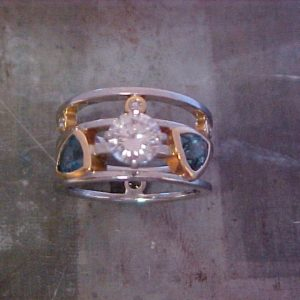custom ring with triangle sapphires and large round center diamond