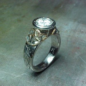 custom medieval inspired celtic ring with large diamond in circular setting