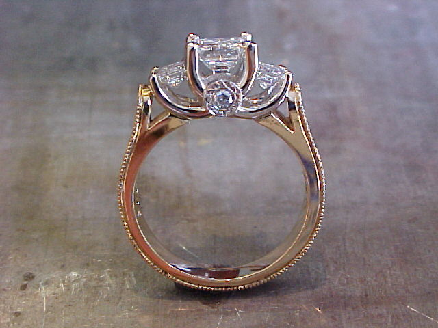 Lotus on side of 3 stone engagement ring