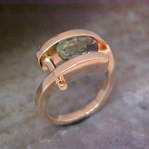 14k gold ring with emerald in tension setting