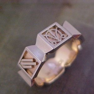 custom engraved symbols on wedding band with unique shape
