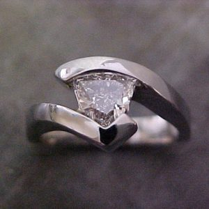 custom white gold engagement ring with tension set triangle diamond