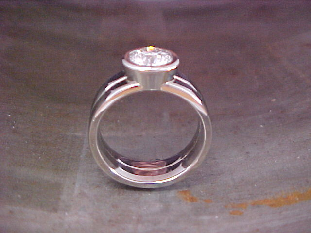 14k white gold custom engagement ring with large round diamond in center
