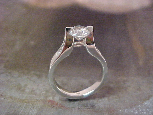 custom white gold engagement ring with tension set princess cut diamond