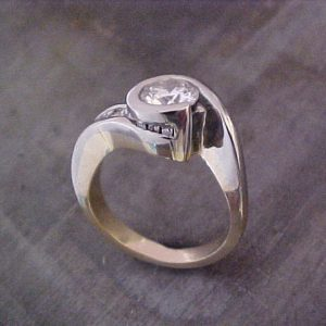 custom assymetrical ring with large center diamond top view