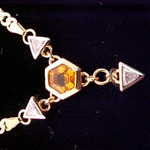custom jewellery necklace with diamonds and yellow gem