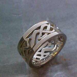 custom wedding band with celtic engraving