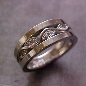 custom wedding ring with wave engraving and diamonds