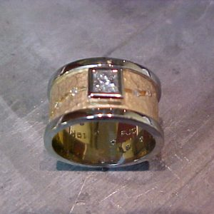 custom wide band with engraving and square set diamond