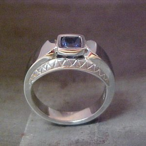 14k white gold custom ring with sapphire center gem side view