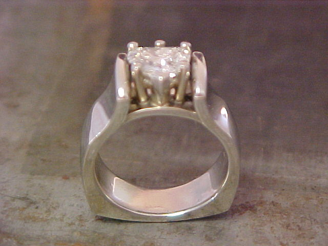 custom solitaire engagement ring