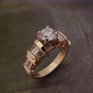 14k gold ring with large center diamond in channel setting