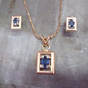 custom jewellery with pendant and matching earrings with sapphire accents