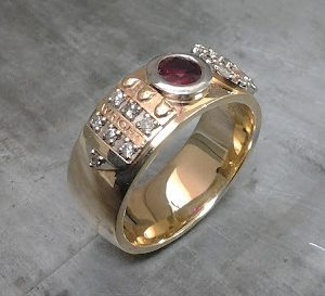 custom engraved wide band with rubies and rose gold
