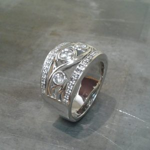 wide band custom swirl design with diamonds side view