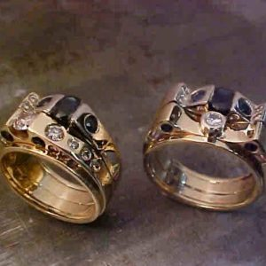 masculine couples matching rings with gold and black diamonds