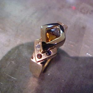 custom gold ring with multiple colored gems